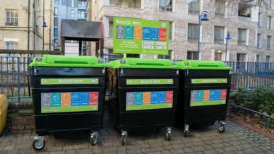 Making recycling work for people in flats: image of three large recycling bins