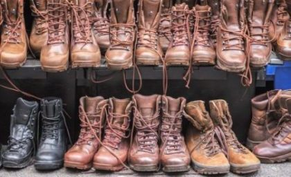 Secondhand combat brown boots on display at Brick Lane Sunday market in London