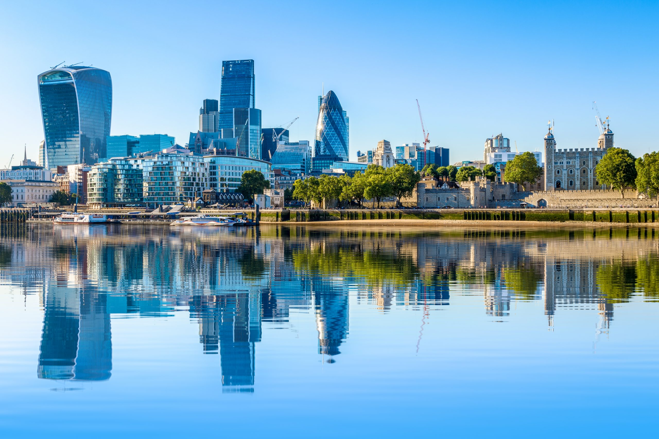 Photograph of a cloudless day at the financial district of London, including The Gherkin, Fenchurch building and Leadenhall building
