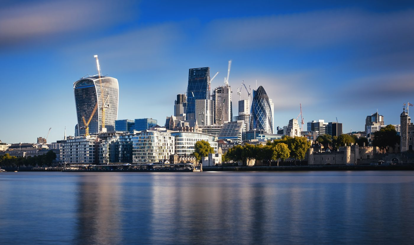 Photograph of London City Skyline at River Thames. Blue sky and sunny day