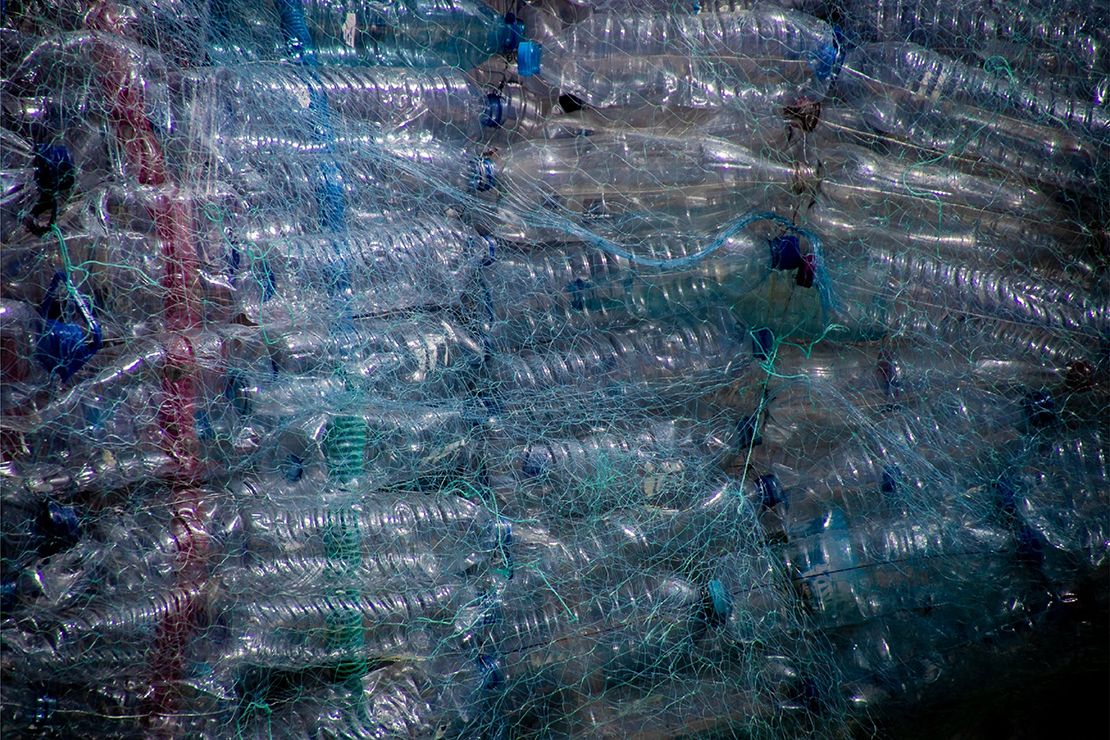 Piles of plastic water bottles in netting