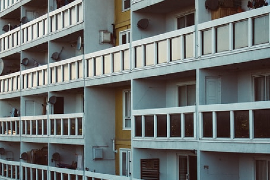 Block of flats with balconies and shared walkways