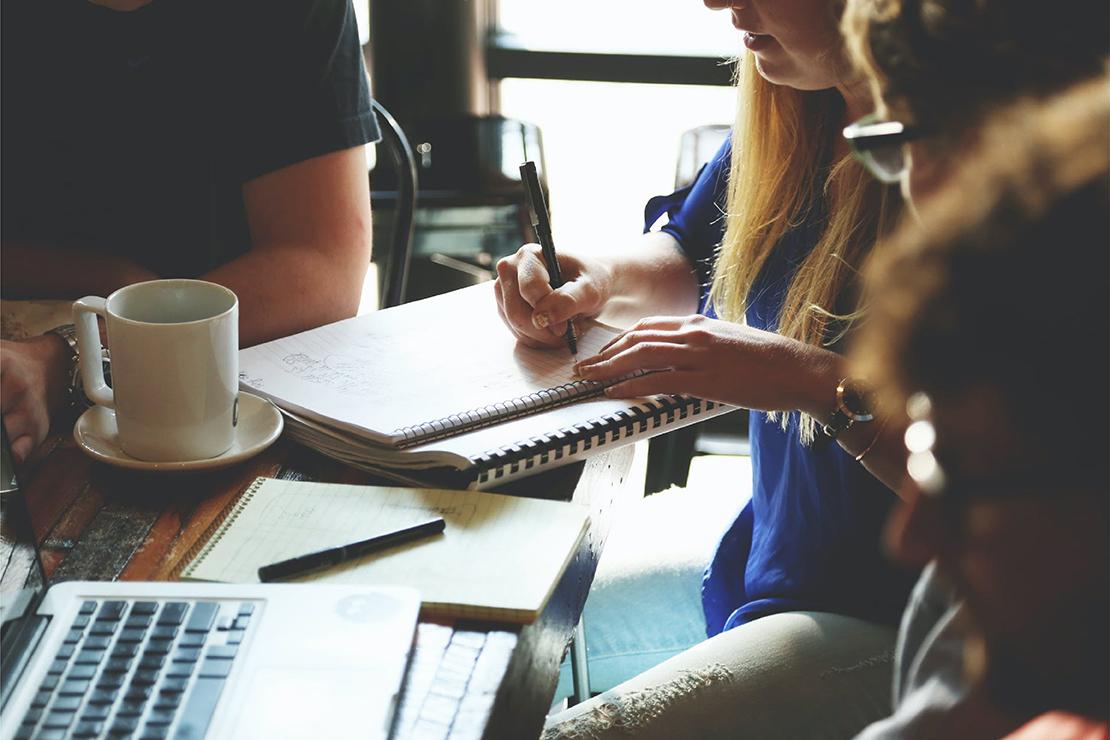Women at a circular economy workshop writing notes